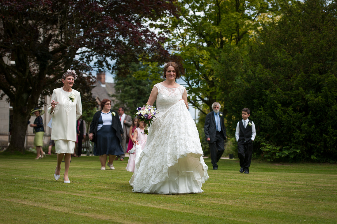Bride walking into the garden